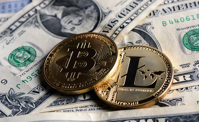 Bitcoin and Litecoin over dollar banknotes.